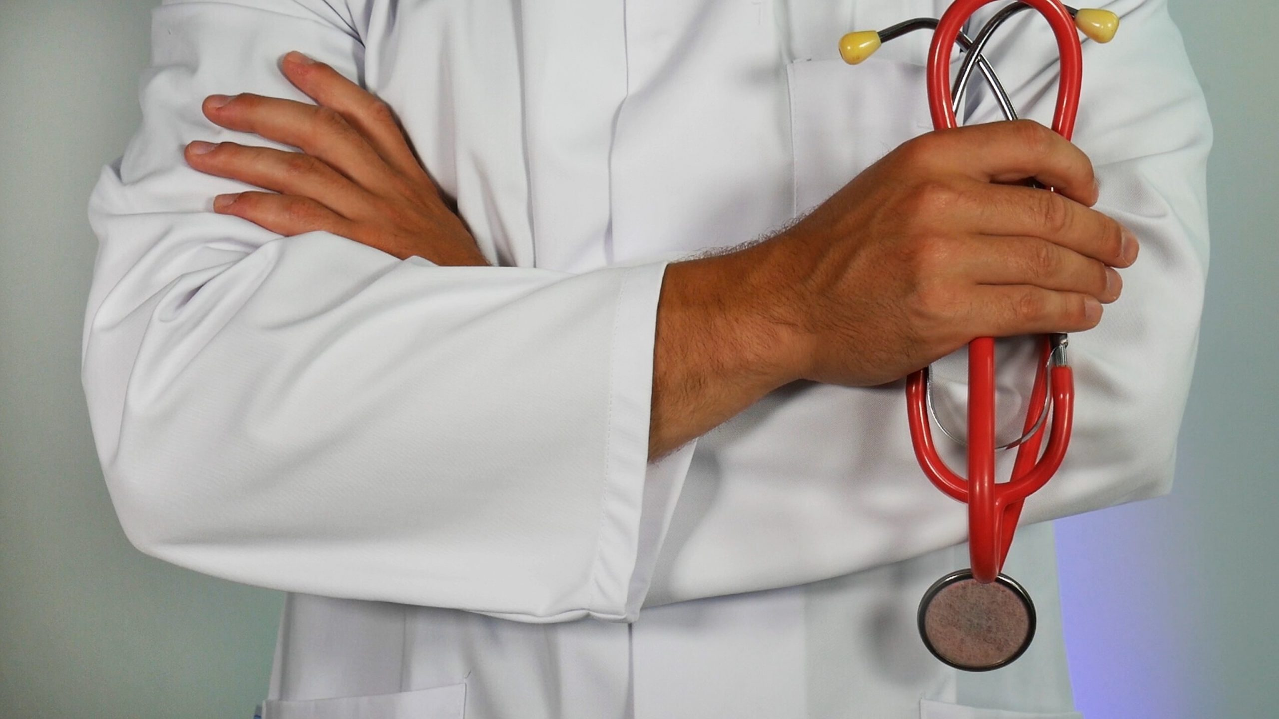 doctor holding a red stethoscope